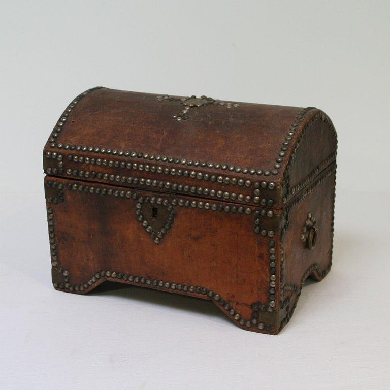 Beautiful weathered Folk Art box made out of wood and cardboard covered with leather. France circa 1900-1930 Weathered, small losses.