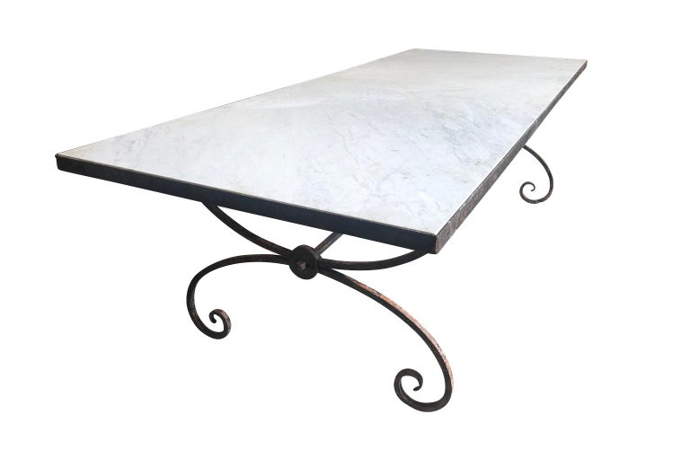 A sensational early 20th century garden dining table from the South of France. Very soundly constructed from beautifully patina'd painted iron with a marble top. The marble is in 2 pieces. Perfect for large family gatherings indoors or out.