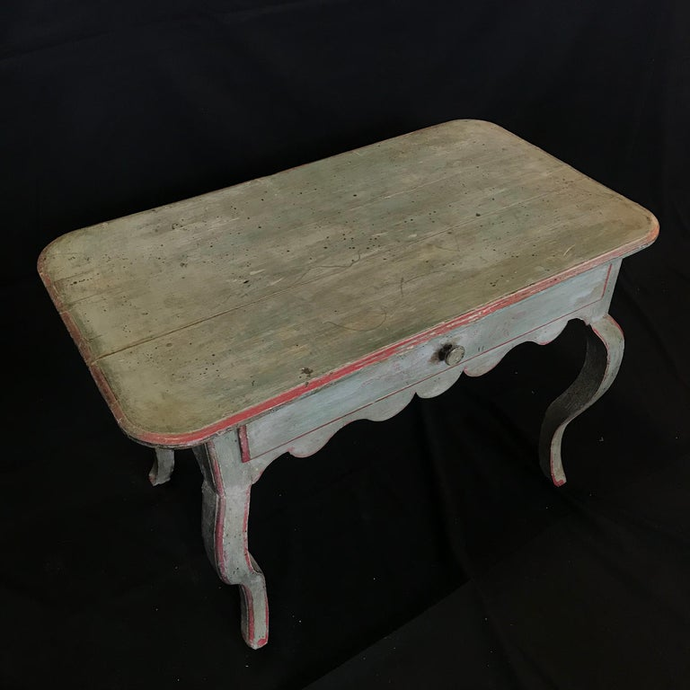 """Versatile French country side table or nightstand with eggshell blue paint, red detailing and gorgeous patina. Single drawer. #1428  H skirt 19.25""""."""