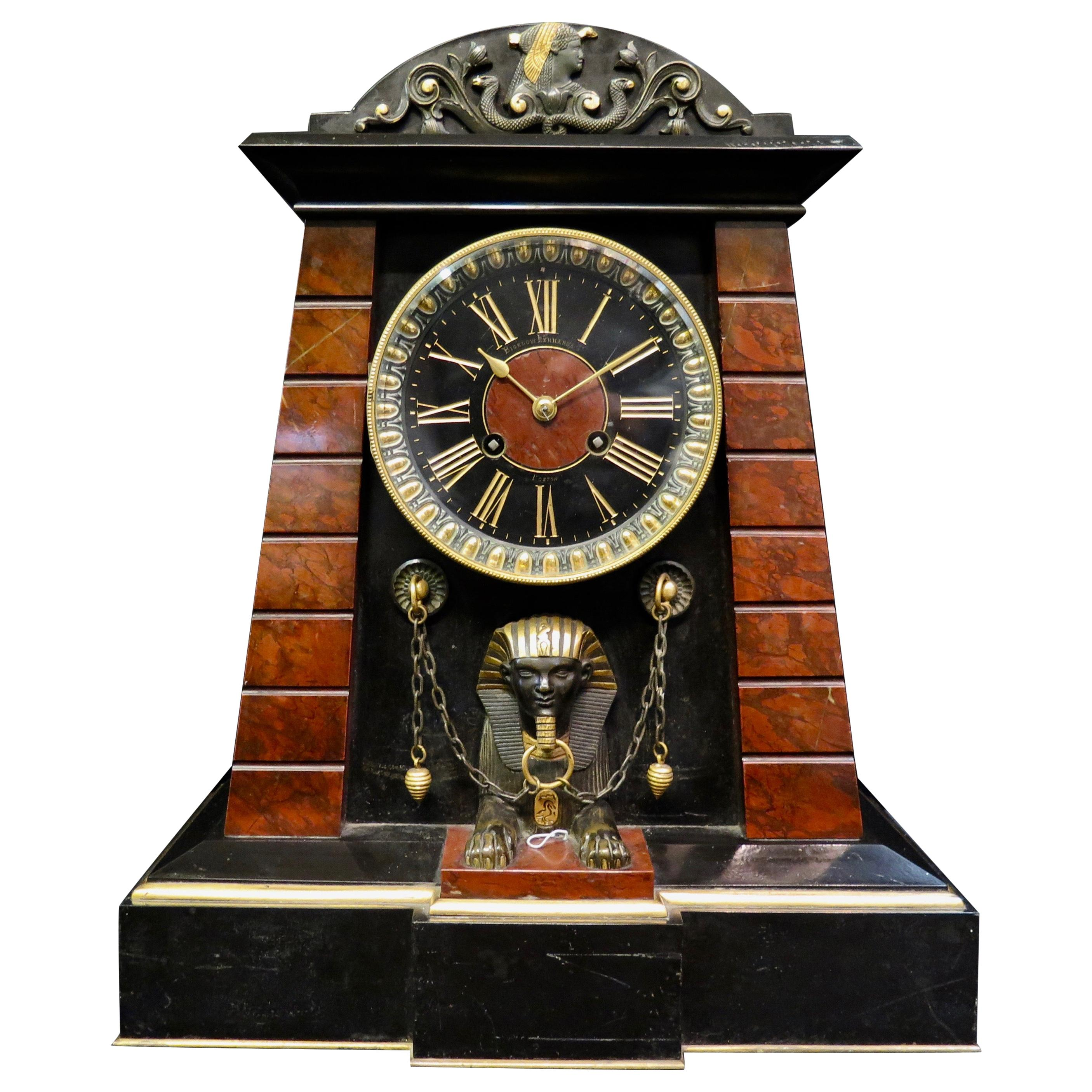 French Egyptian Revival Patinated Bronze and Marble Mantle Clock