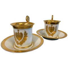 French Empire 2 Paris Porcelain Cups and Saucers with Family Emblem, circa 1820