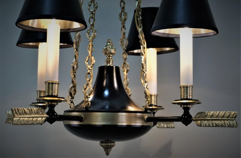 French Empire style four-light bronze and black lacquer finished chandelier.