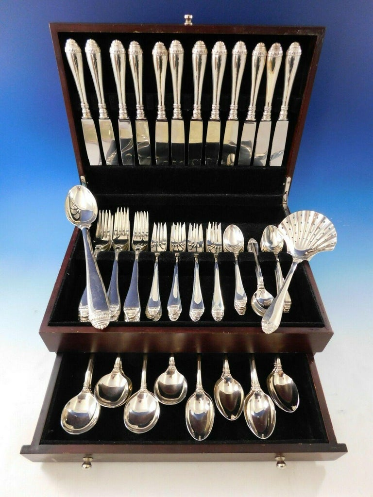 Superb French Empire by Buccellati Italy sterling silver dinner flatware set - 74 Pieces. This exceptional service is comprised of:  12 dinner knives, 10