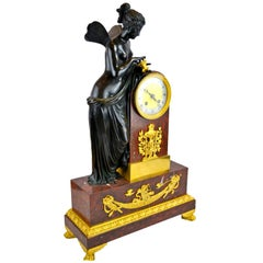 French Empire Clock Depicting Psyche Playing with a Butterfly after Canova