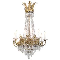 Französischer Acht-Lichter Kronleuchter aus geschliffenem Kristall und Bronze im Empire Stil, aus dem frühen 20. Jahrhundert