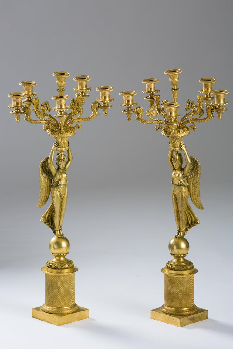 A pair of French empire gilded bronze candelabras, circa 1815