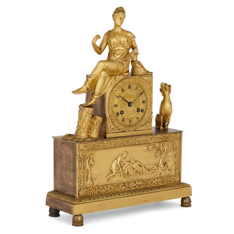 French Empire gilt bronze clock French, early 19th century Measures: Height 38cm, width 27cm, depth 10cm  This fine gilt bronze mantel clock is an excellent example of the manner and style of clock that predominated during the Empire