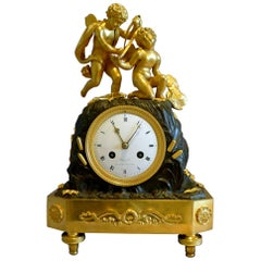 French Empire Mantel Clock of Two Cupids Signed Coeur
