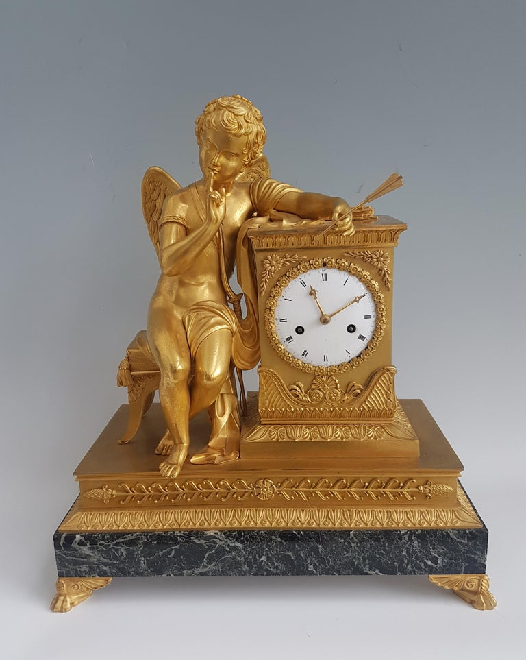 Early 19th Century French Empire Ormolu and Marble Mantel Clock of Cupid For Sale