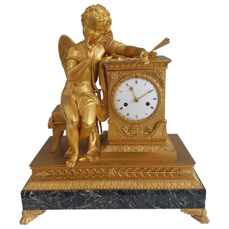 French Empire Ormolu and Marble Mantel Clock of Cupid For Sale