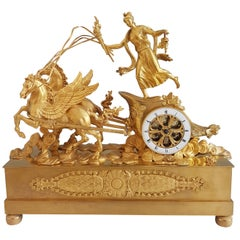 French Empire Ormolu Mantel Clock of Aurora in Her Chariot Pulled by Her Winged