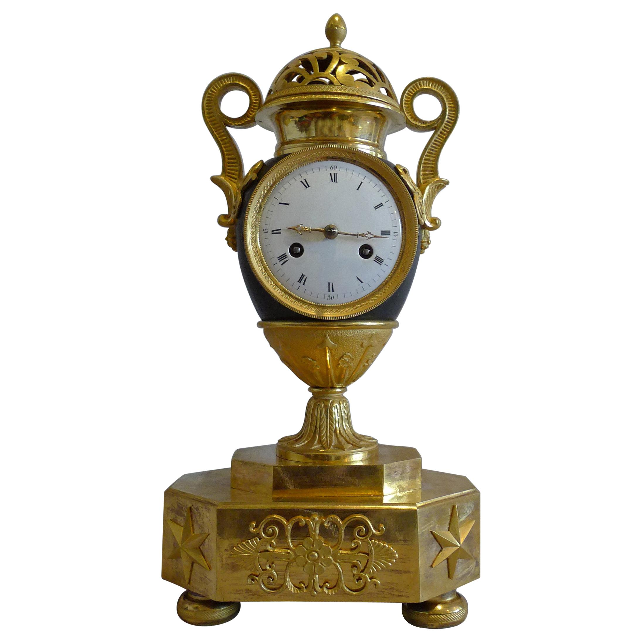French Empire Patinated Bronze and Ormolu Vase Clock
