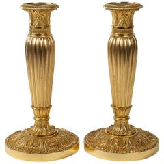 French Empire Period, Pair of Chiseled Gilt-Bronze Candlesticks, circa 1805-1810