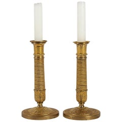 French Empire Period, Pair of Small Chiseled Gilt-Bronze Candlesticks circa 1805