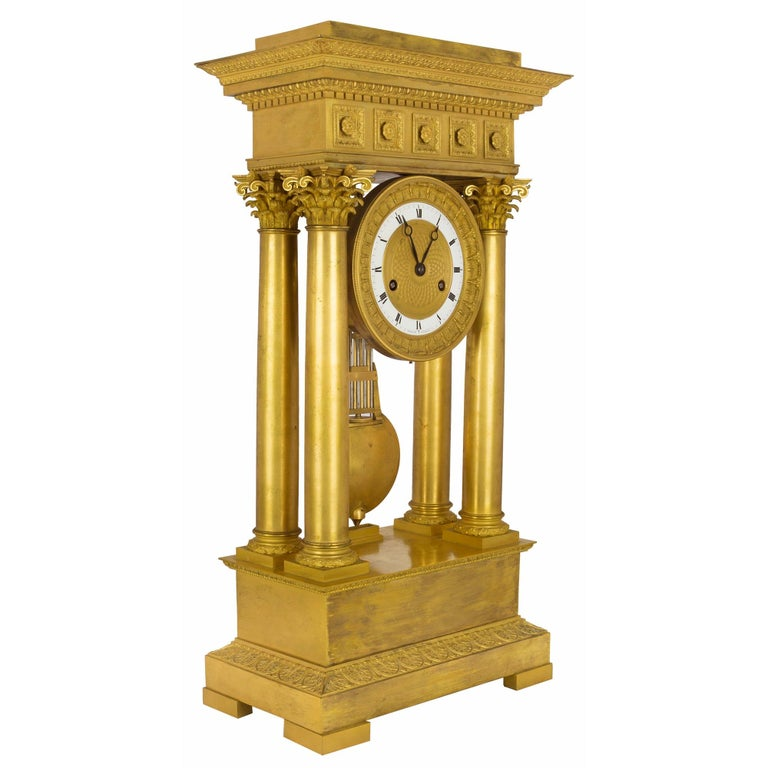 An important French mid 19th century Empire st. ormolu clock, signed Petit a Paris. The clock is raised by a rectangular ormolu base, below four columns, each topped with a Corinthian capitol. At The center is the impressive ormolu and white enamel