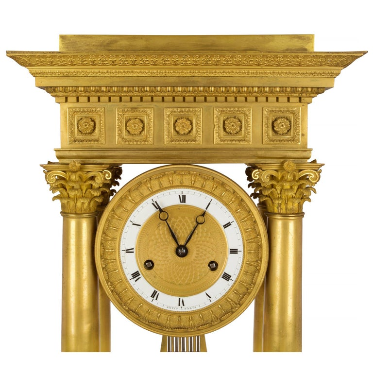 Empire French empire st. mid 19th century ormolu clock, signed 'petit a Paris' For Sale