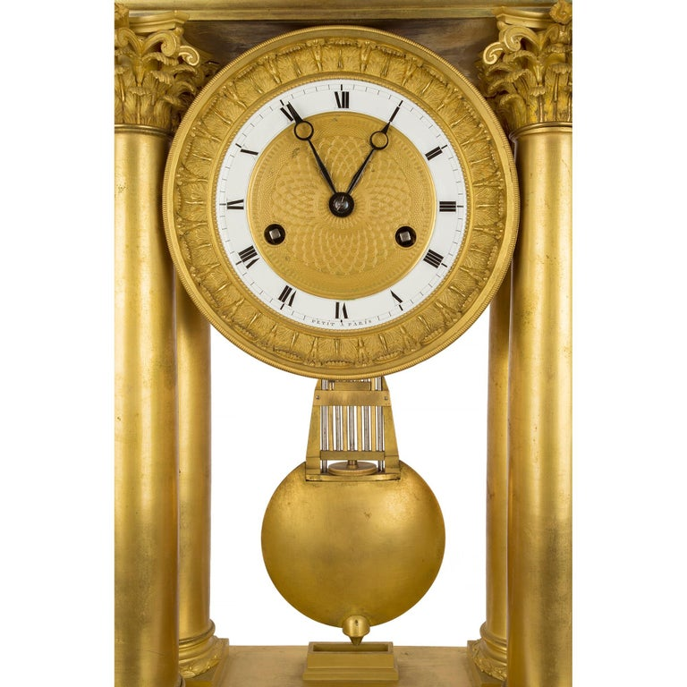 French empire st. mid 19th century ormolu clock, signed 'petit a Paris' In Excellent Condition For Sale In West Palm Beach, FL