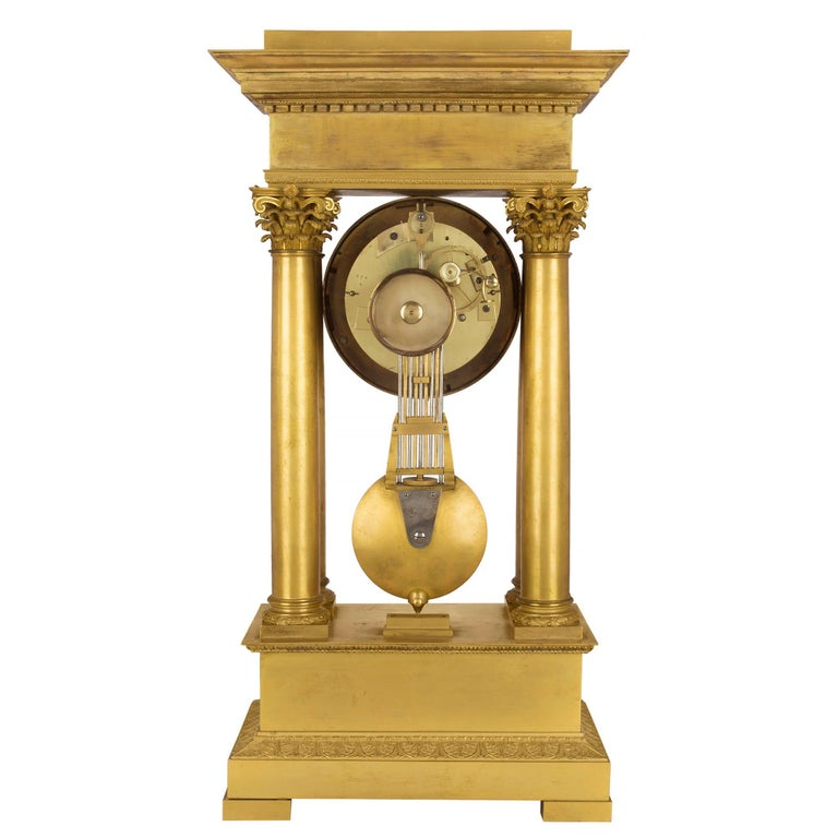 19th Century French empire st. mid 19th century ormolu clock, signed 'petit a Paris' For Sale