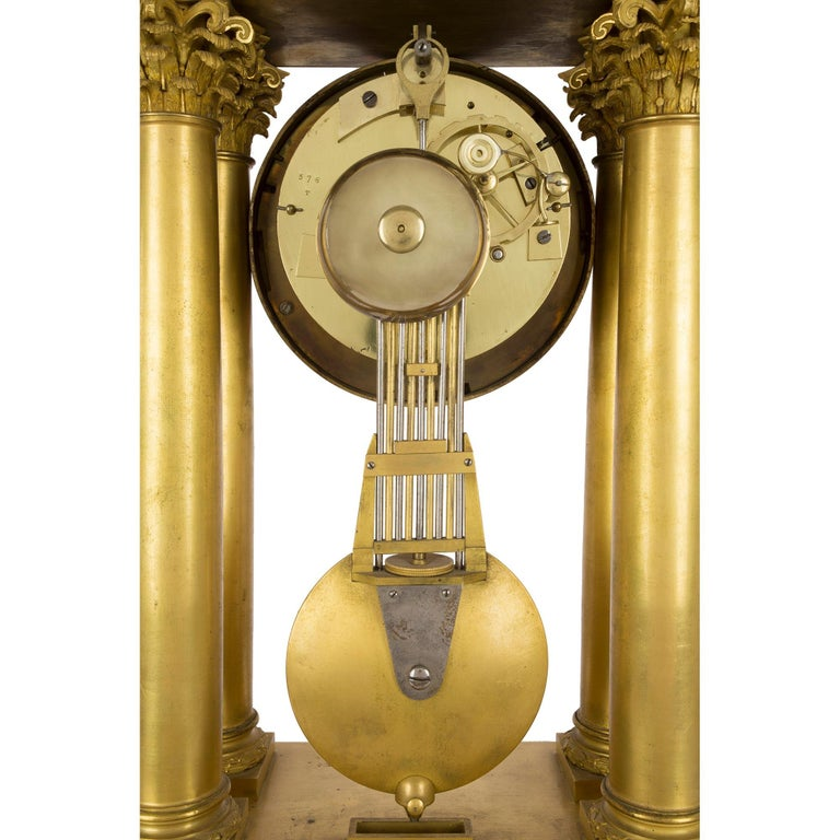 Metal French empire st. mid 19th century ormolu clock, signed 'petit a Paris' For Sale