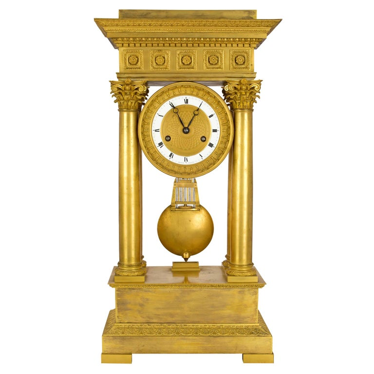 French empire st. mid 19th century ormolu clock, signed 'petit a Paris' For Sale
