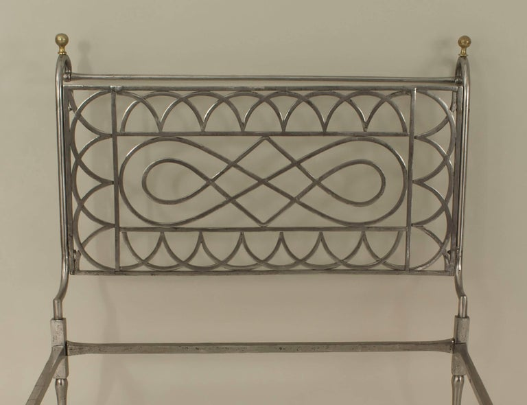 French Empire style (19th-20th century) steel and brass trimmed daybed with open arch and scroll design sides.