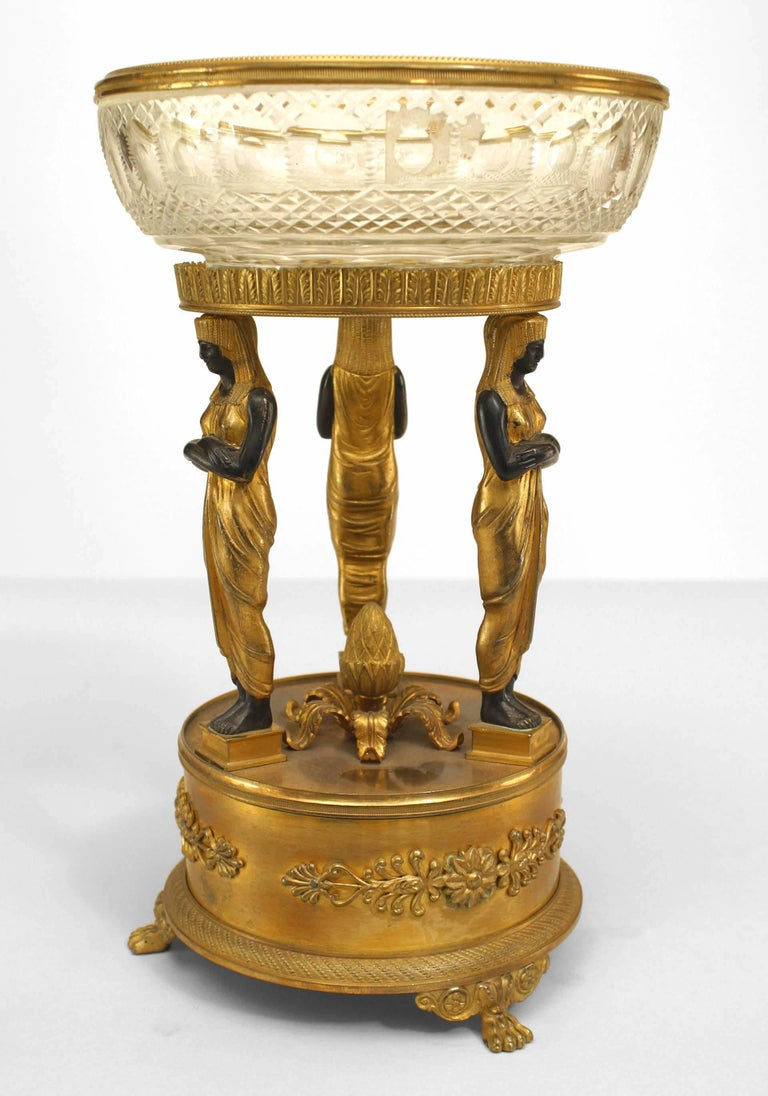 French Empire style, 19th century bronze doré compote with three Egyptian ebonized figures and crystal bowl.