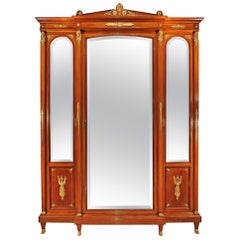 French Empire Style 19th Century Three Door Armoire in Satinwood and Mahogany