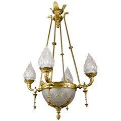 French Empire Style Bronze and Frosted Flame Glass Shades Eight-Light Chandelier