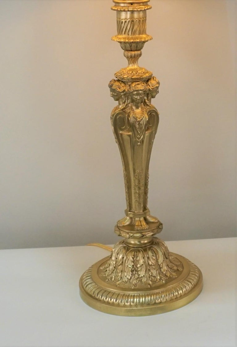 Earl 20th century classic design electrified large candlestick to an elegant table lamp.