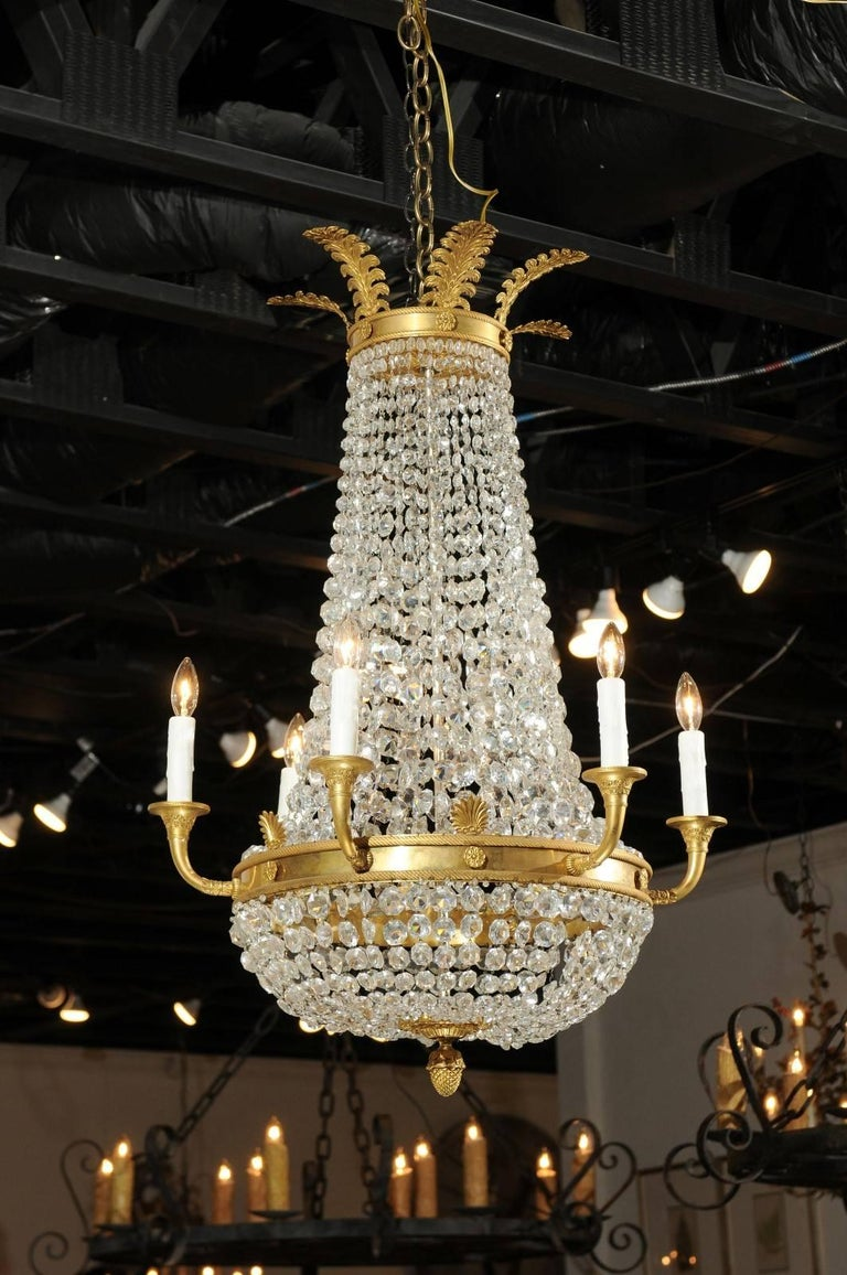 French empire style crystal and gilt metal waterfall basket six arm a french empire style crystal and gilt metal waterfall basket six light chandelier from the aloadofball Choice Image