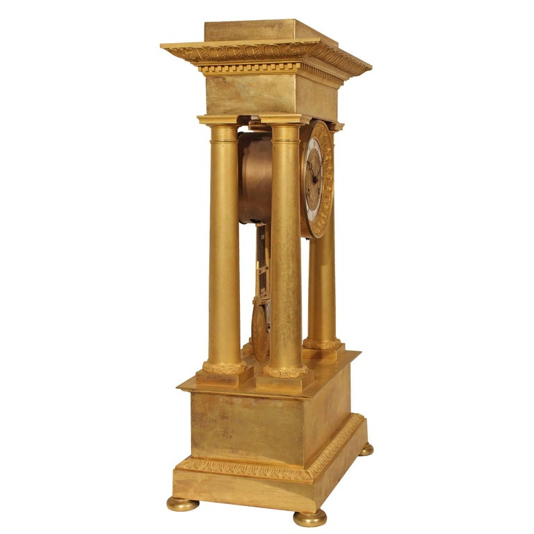 An exquisite French mid 19th century Empire st. ormolu clock. The clock raised on a rectangular base with finely chased borders. Above four ormolu columns support the impressive top capitol with finely chased borders. Centered are the very