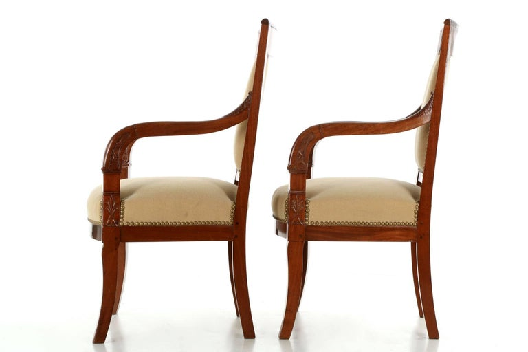 The deep ruby hues of the brilliant high polish mahogany primary woods on both chairs is just gorgeous. Designed clearly in the Empire taste, the pair is probably from the turn of the century while being crafted with earlier techniques - the seat