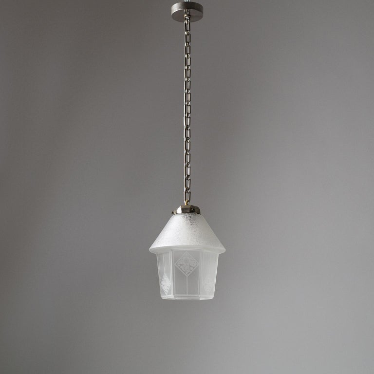Rare 1940s French Art Deco lantern with a house shaped glass diffuser. Suspended from nickeled brass hardware the glass has an intricate etched decor as well as a satin finish. Fine original condition with patina on the nickeled brass parts. One