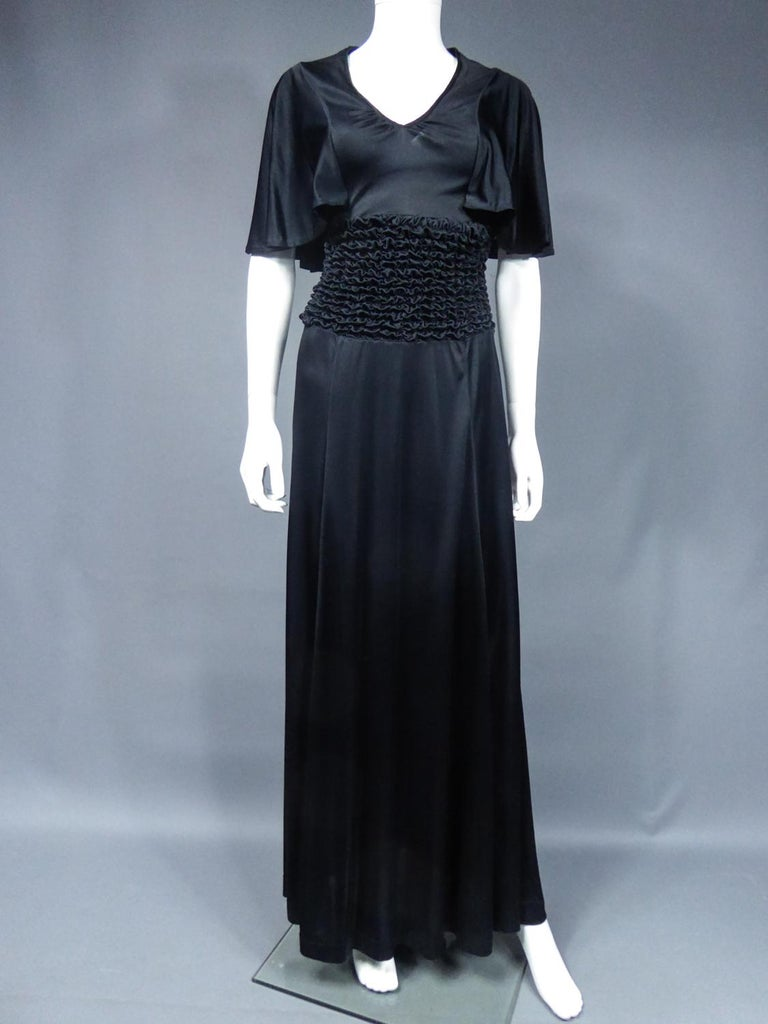 Black French Evening Dress in Smocked Jersey Circa 1990 For Sale