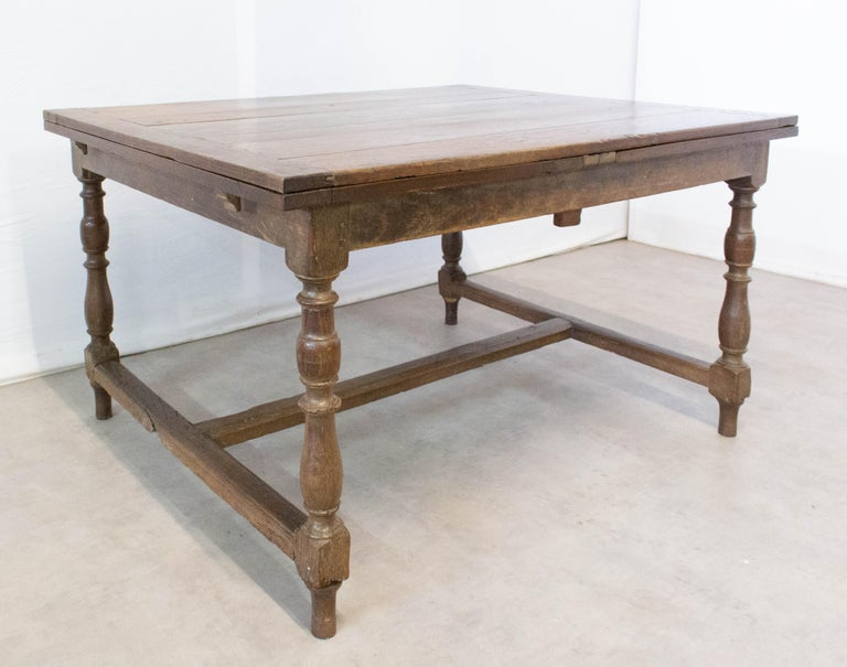 19th century solid oak dining extendable table from France It will extend to 100 in. (254 cm) Good antique condition, with minor signs of wear please see photos.  For shipping: 132 x 75 x 104cm 70kg.