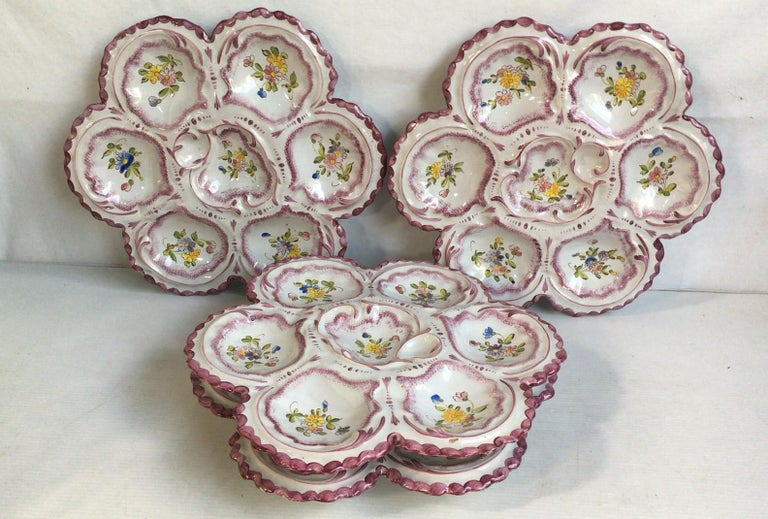 Lovely large French faience oyster plate in pastel colors with flowers, circa 1900 signed Alfred Renoleau Angouleme.