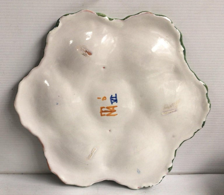 French Faience rustic oyster plate Moustiers style, circa 1940. Painting of flowers and bird on the center.