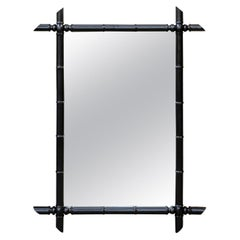 French Faux Bamboo Black Painted Mirror with Protruding Corners from the 1920s