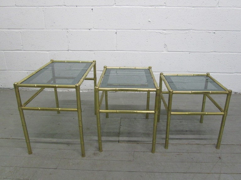 Brass French nesting tables with smoked glass tops. Maison Baguès style. Large measures: 21.5
