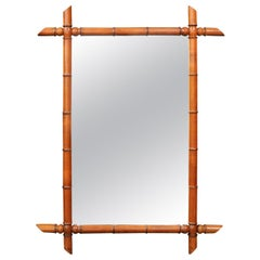 French Faux Bamboo Rectangular Mirror with Protruding Corners from the 1920s