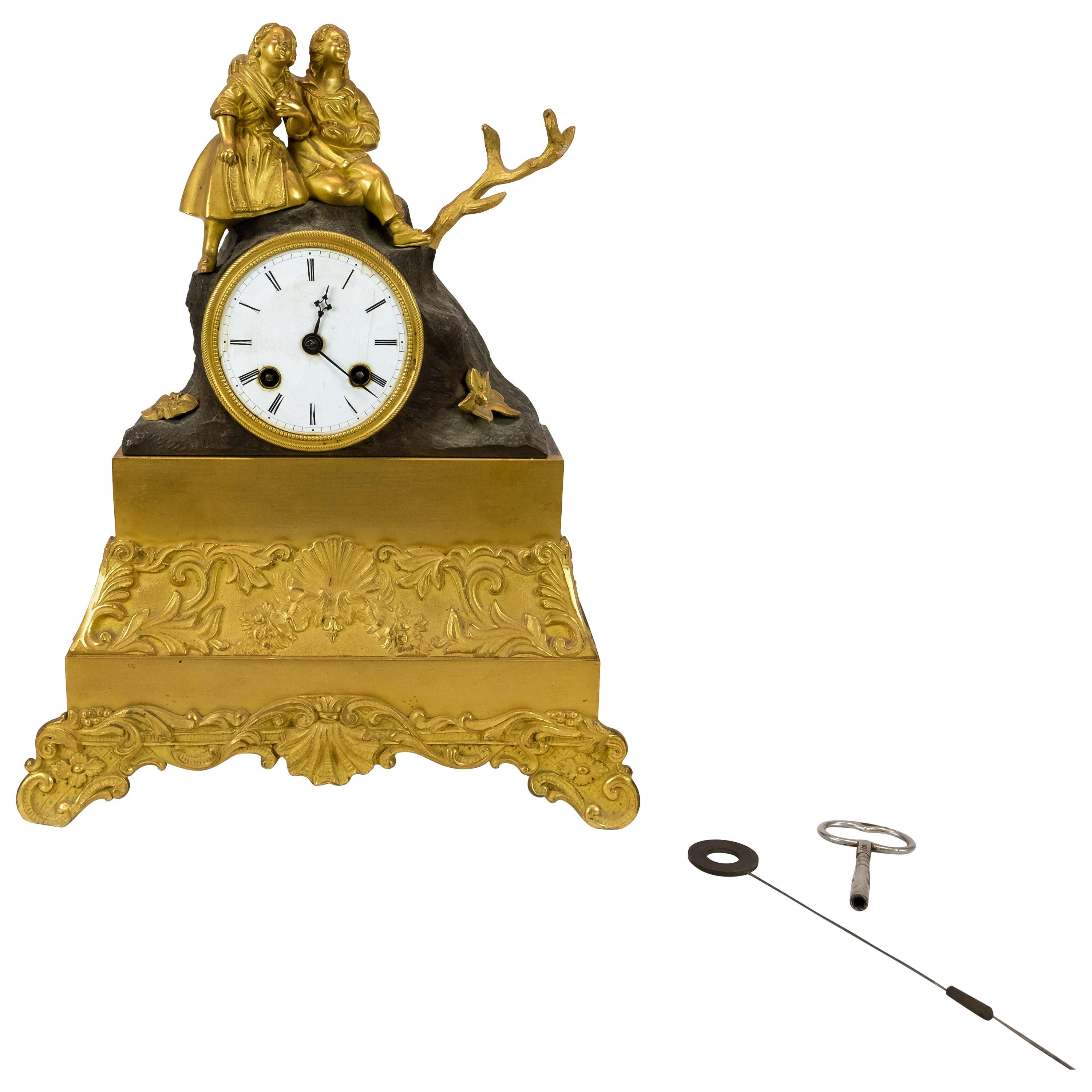 French Fireplace Clock of Gilded Bronze from circa 1820s