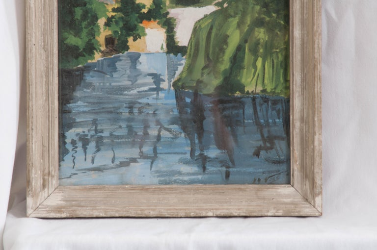 Robust in color, this 19th century, French watercolor on paper with glass is signed by the artist, and framed in distressed wood.
