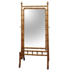 French Freestanding Faux-Bamboo Cheval Mirror with Saber Legs from the 1870s
