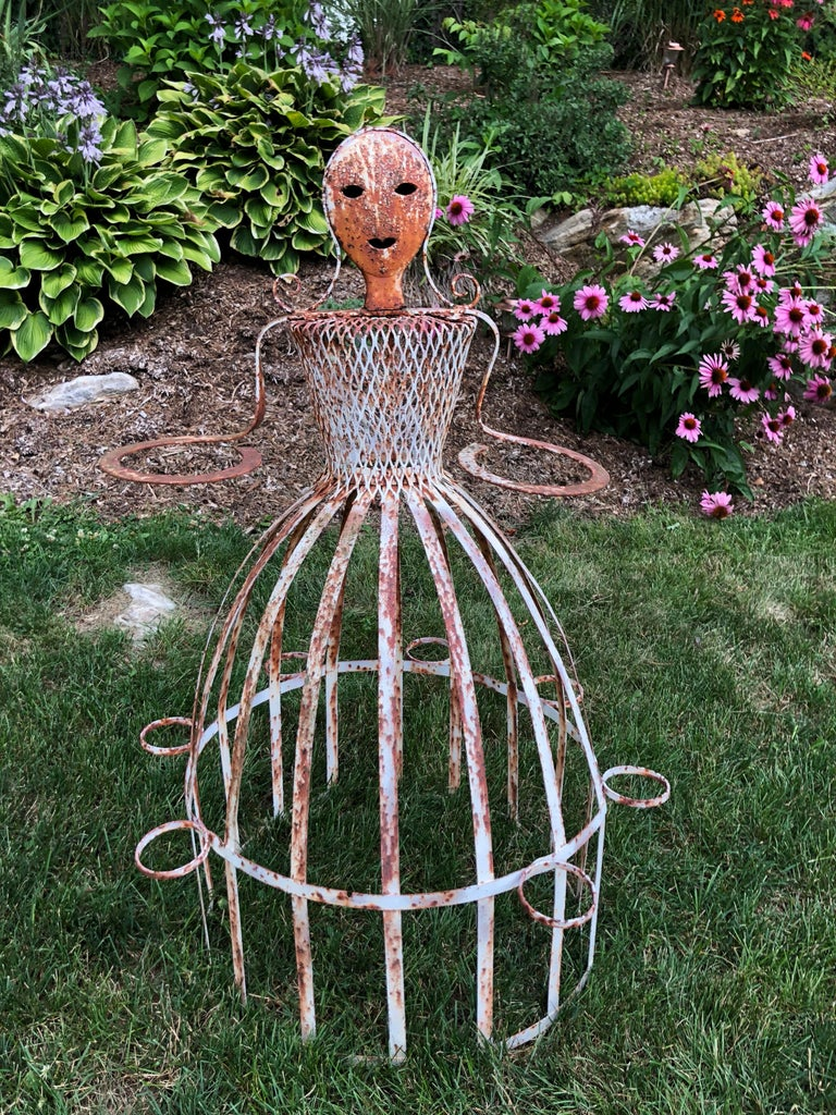 French garden planter in the shape of a Maiden. Attributed to Colette Guerdon. Iron whimsical garden ornament. Can be repainted if desired or leave rustic and distressed. Has circular pot holders around her hands as well as the rim of her dress to