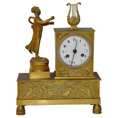 French Gilded Bronze Mantle Clock with Standing Figure, circa 1840s