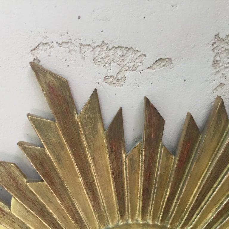 French midcentury gilded wood sunburst convex mirror, circa 1950.
