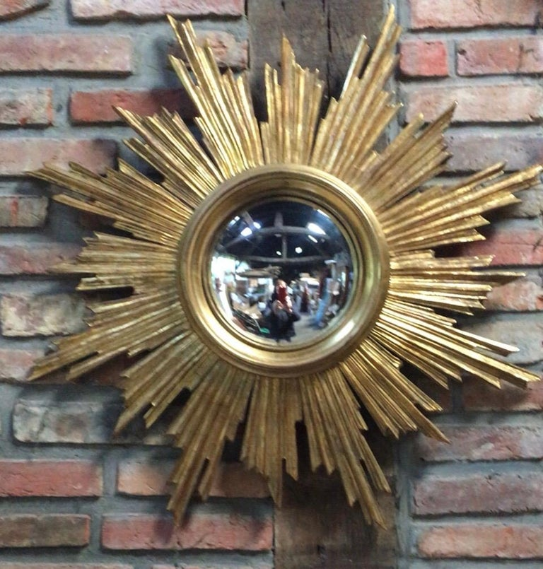 French midcentury gilded wood sunburst convex mirror, circa 1950. Measures: Diameter / 27.5 inches.