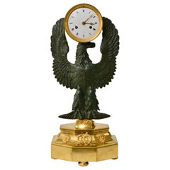 French Gilt and Patinated Empire Bronze Clock