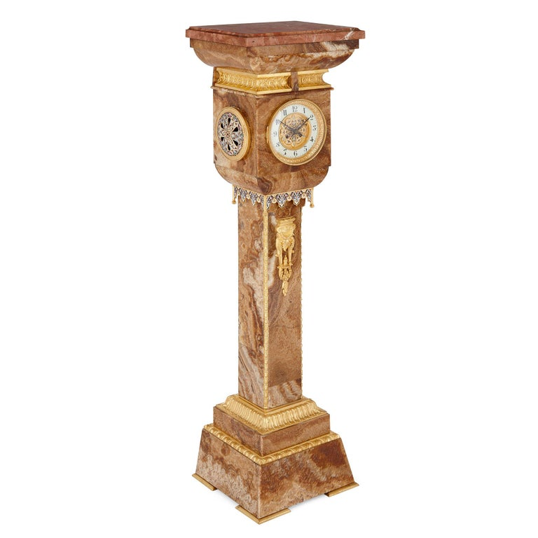French gilt bronze and enamel mounted onyx standing clock French, late 19th century Height 126cm, width 36cm, depth 27cm  This beautiful pedestal clock is crafted in a wonderful Renaissance inspired style from red onyx. The pedestal of the clock