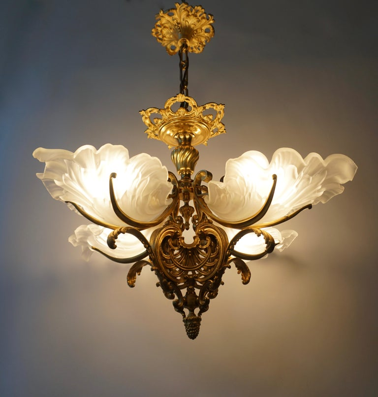 French Louis XVI style gilt bronze and frosted glass chandelier with original gilding.The light created by this chandelier is very pleasant and ambient.